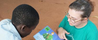 Volunteer with children in Togo